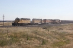 Two UP and Two BNSF Units Pull Herzog Ballast Train West of Cheyenne